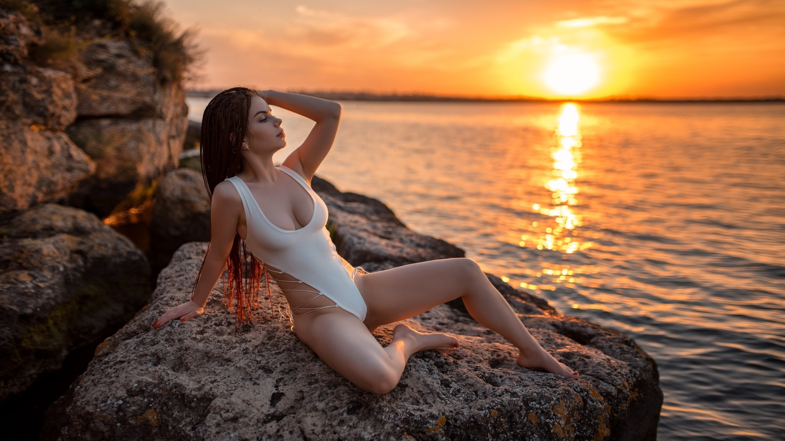 women, one-piece swimsuit, rocks, sunset, women outdoors, brunette, sea, sky, sitting, red nails, long hair