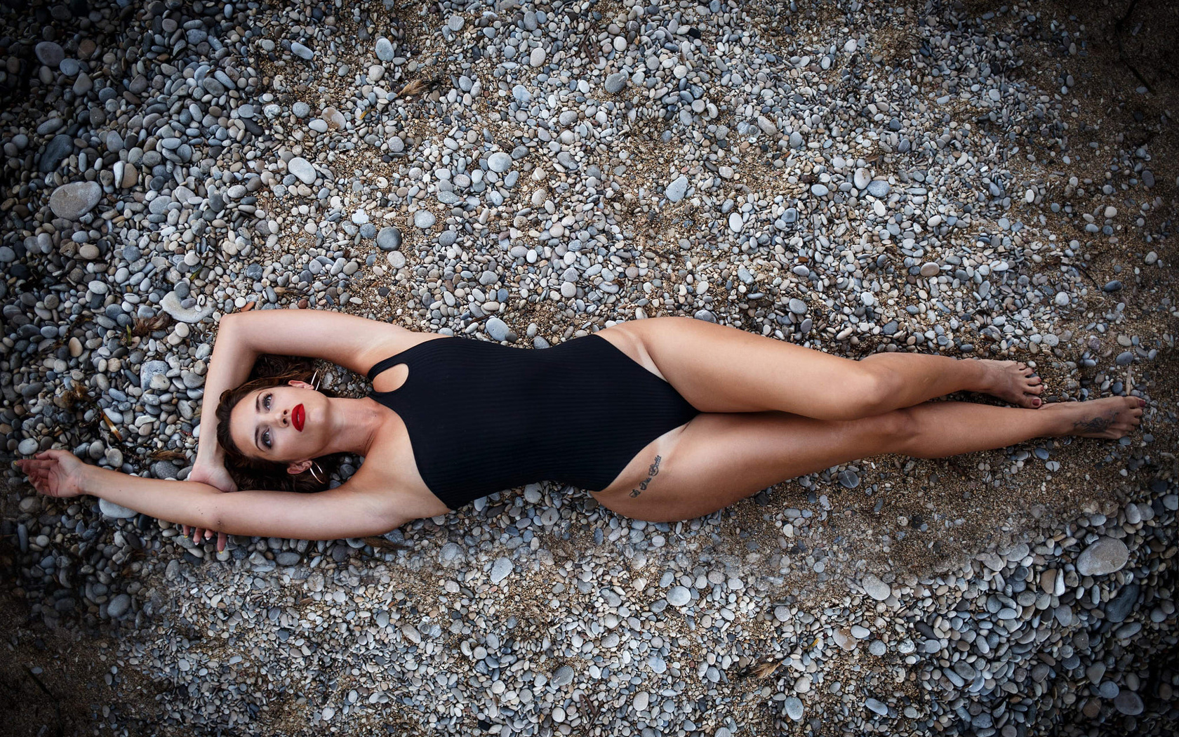 women, top view, armpits, hips, tan lines, red lipstick, tattoo, lying on back, one-piece swimsuit, brunette
