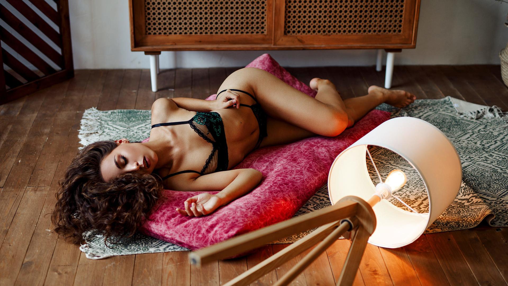 women, on the floor, lamp, light bulb, closed eyes, wooden floor, women indoors, ribs, black lingerie, belly, brunette