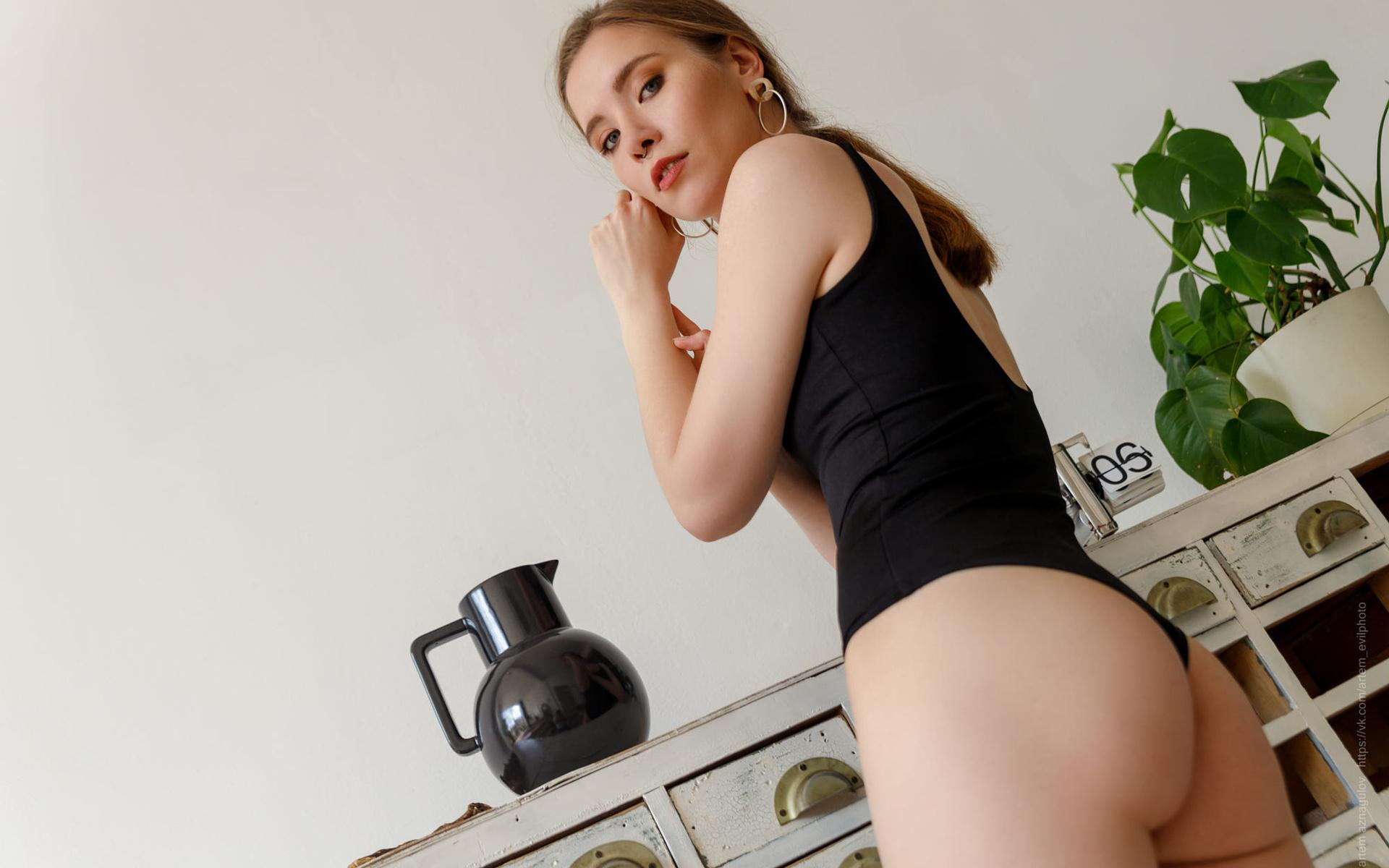 women, ass, women indoors, blonde, bodysuit, plants, wall, hoop earrings, looking at viewer