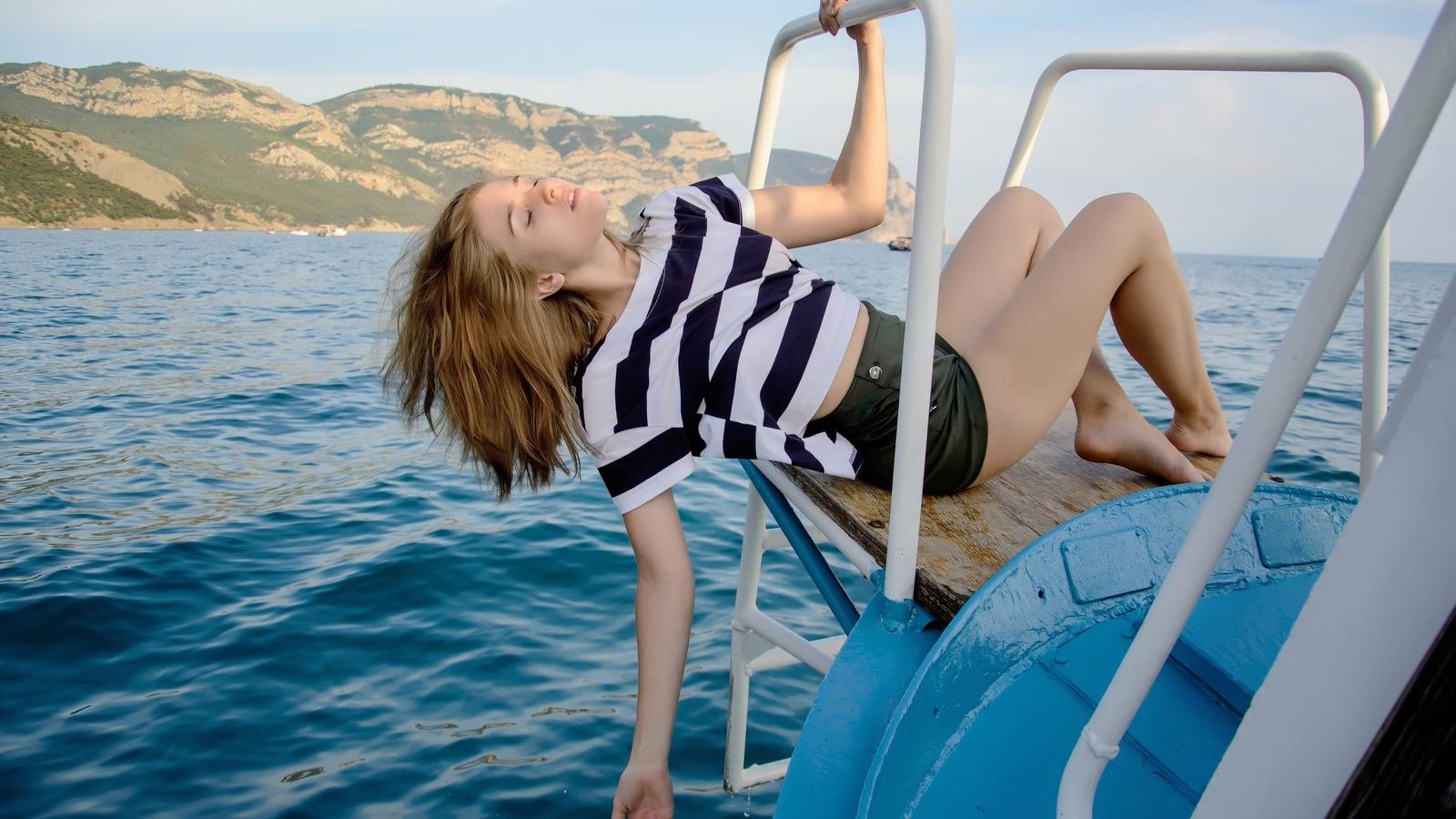 dmitry plotnikoff, carolina kris, boat, model, women, blonde, shorts, sea, barefoot, island, women outdoors, closed eyes, t-shirt